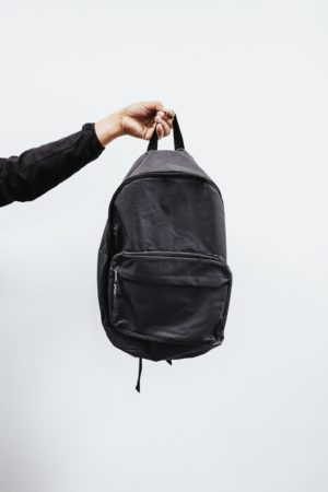 person-holding-black-backpack-3731256